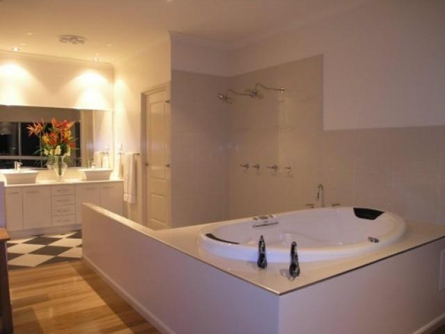 Our handy work gets bathrooms glistening